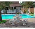 Благоустройство двора - фонтан с бассейном, садовый стол со скамейками
